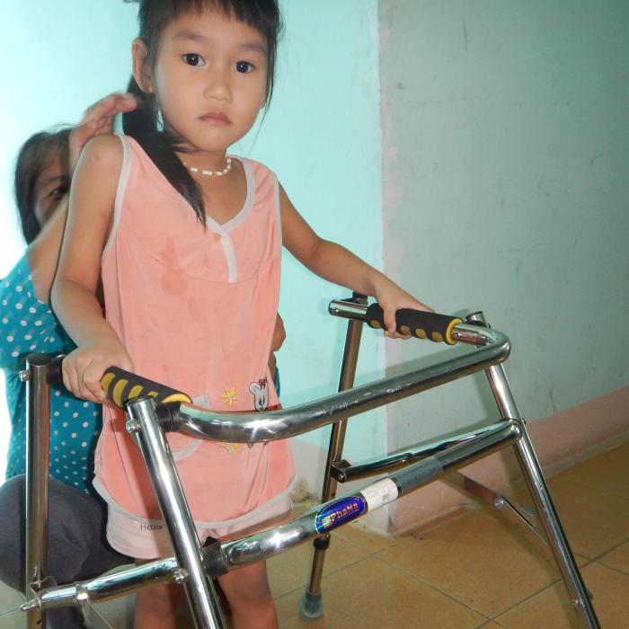 A young girl with a walker