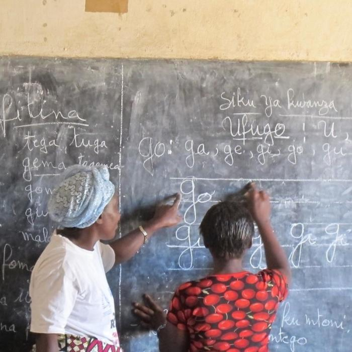 Photo: A young woman participates in an USAID-supported literacy class in Kalemie, DRC, June 2012