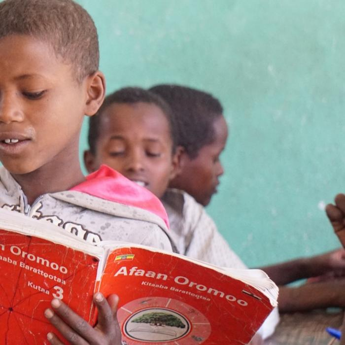 A student in Ethiopia are working to improve their reading skills.
