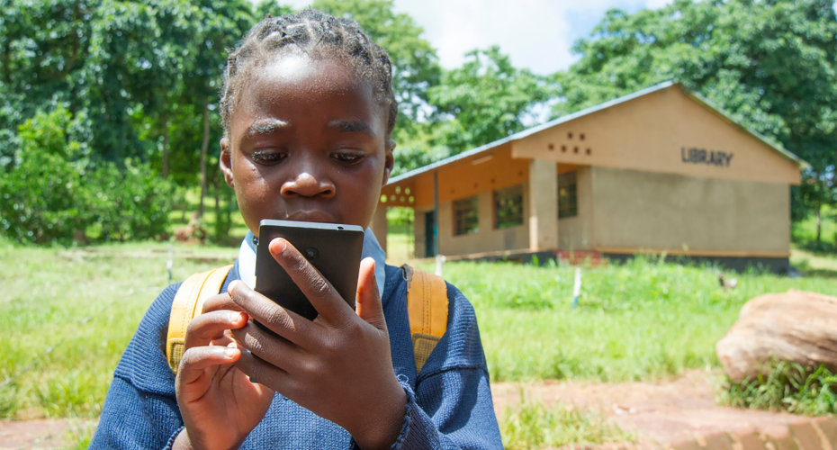 A young child using a mobile phone