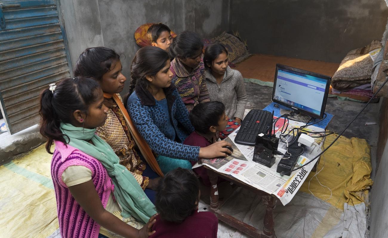 Photo: A group of youth members using digital content as a part of the digital intervention