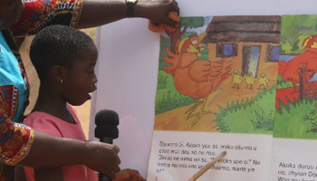 Photo: A pupil reading a story written in Twi, a Ghanaian language, to the audience during the Ashanti Region's Reading Festival in Offinso.