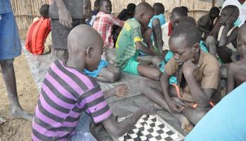 Internally displaced school children play chess at a child-friendly space at Rubkona,  Bentiu.