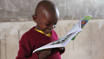 A student reading a book. Photo by Eric Onyiego/USAID Kenya