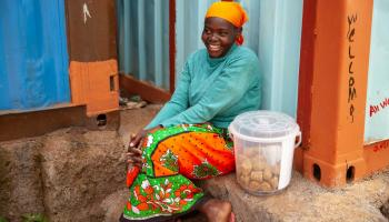 Photo: Maureen Achieng participated in mentorship to learn new business skills for selling peanut snacks at the market.